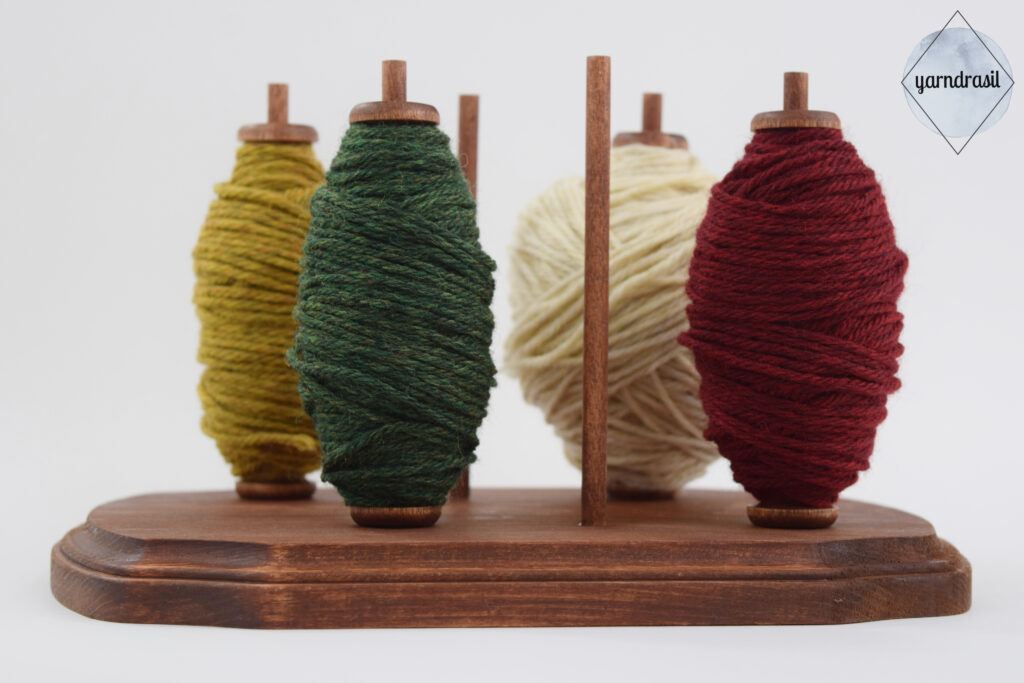 Bobbins with yarn wound on to them