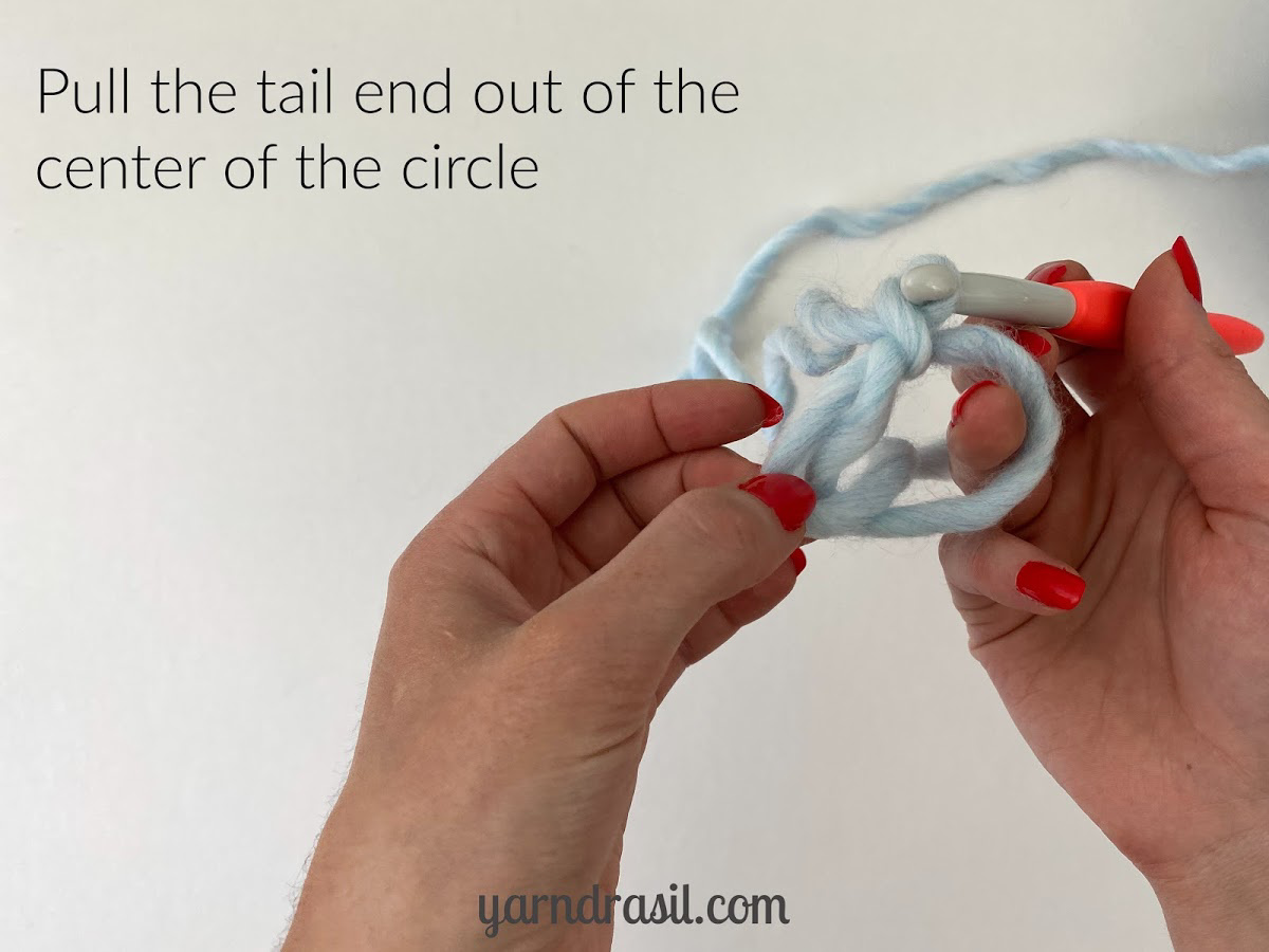 Pull the tail end out of the center of the circle