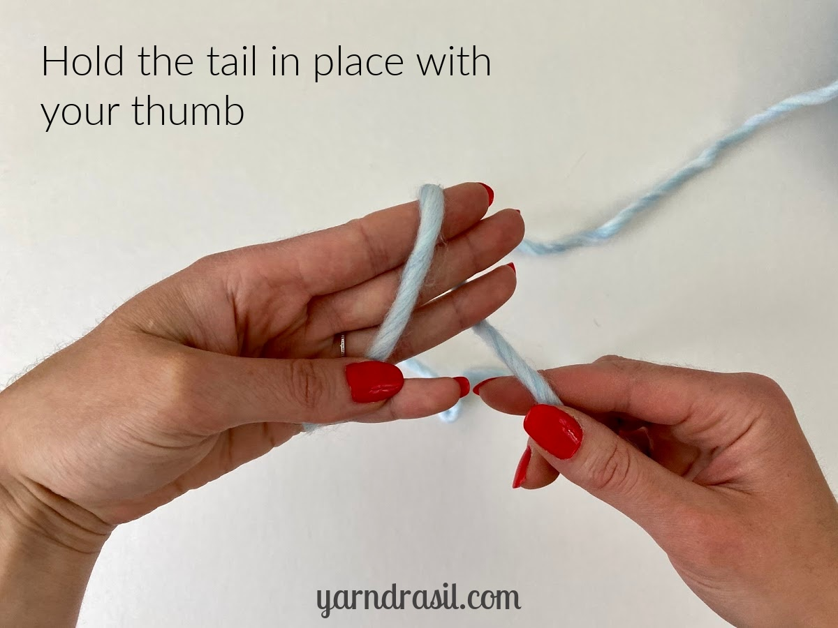 Hold the tail end in place with your thumb