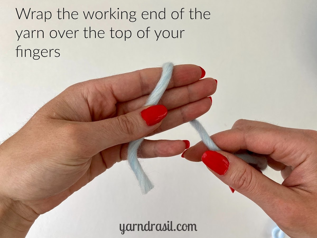 Wrap the working end of the yarn over the top of your fingers