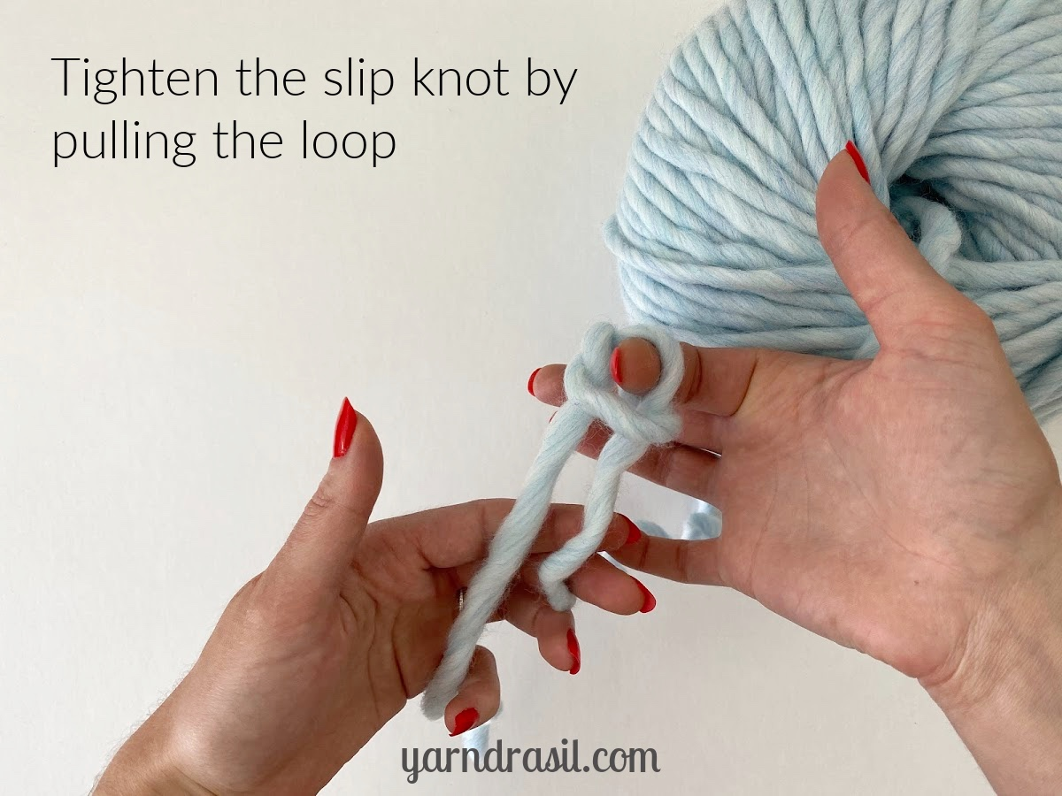 Tighten the slip knot by pulling the loop