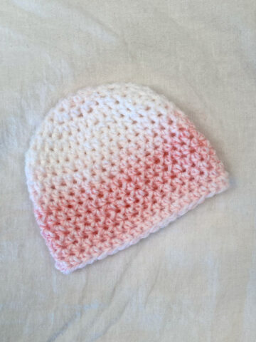 Closeup of pink and white ombre preemie hat for babies