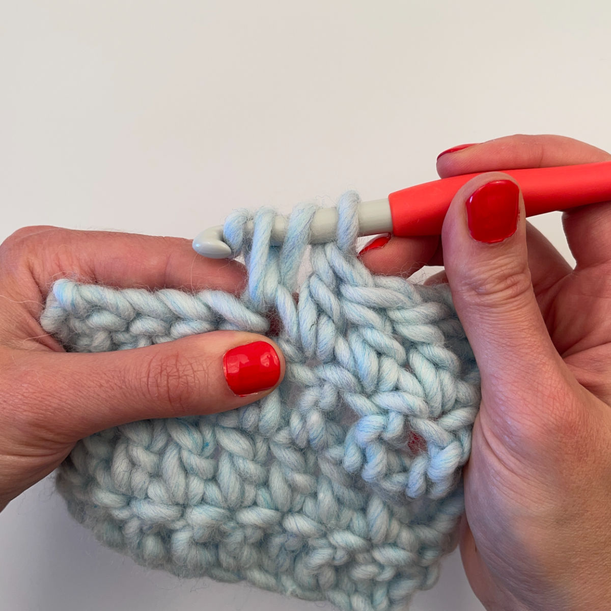Step 4: Yarn over and pull through 2 loops